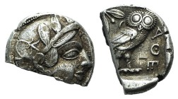 Attica, Athens, c. 454-404 BC. AR Tetradrachm (23mm, 11.57g, 10h). Helmeted head of Athena r. R/ Owl standing r., head facing; olive sprig behind; all...