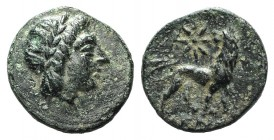 Ionia, Miletos, c. 350-325 BC. Æ (11mm, 1.03g, 12h). Dionysos, magistrate. Laureate head of Apollo r. R/ Lion standing r., head l.; star above. Cf. SN...