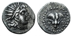 Islands off Caria, Rhodes, c. 188-84. AR Diobol (11mm, 0.84g, 12h). Radiate head of Helios r. R/ Rose; all within bearded circle. SNG Keckman 699 var....