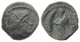 Celtic, Southern Gaul. Volcae-Arecomici, c. 77-44 BC. Æ (14mm, 1.91g, 12h). Diademed head of Artemis r. R/ Togate male figure standing l.; palm to l. ...
