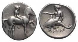 Southern Apulia, Tarentum, c. 365-355 BC. AR Nomos (21mm, 7.96g, 3h). Nude youth on horseback r.; small Θ below. R/ Phalanthos on dolphin l.; Θ below....