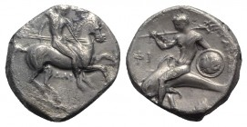 Southern Apulia, Tarentum, c. 332-302 BC. AR Nomos (20mm, 7.63g, 12h). Warrior, holding shield and two spears, preparing to cast a third, on horseback...