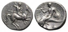 Southern Apulia, Tarentum, c. 332-302 BC. AR Nomos (20mm, 7.60g, 5h). Warrior, holding shield and two spears, preparing to cast a third, on horseback ...
