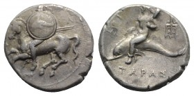 Southern Apulia, Tarentum, c. 220-281 BC. AR Nomos (20mm, 7.70g, 5h). Warrior, holding two spears and shield decorated with dolphin, on horseback l.; ...