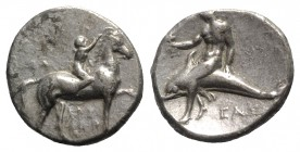 Southern Apulia, Tarentum, c. 320-280 BC. AR Nomos (21mm, 7.69g, 11h). Youth on horseback r., crowning horse; ΣA to l., APE/ΘΩN in two lines below. R/...