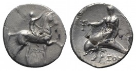 Southern Apulia, Tarentum, c. 320-280 BC. AR Nomos (20mm, 6.45g, 2h). Youth on horseback r., crowning horse; AΓΩ to l., KPAT/INOΣ below. R/ Phalanthos...