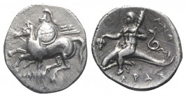Southern Apulia, Tarentum, c. 280-272 BC. AR Nomos (21mm, 6.44g, 2h). Horseman l., holding shield and two spears; ZΩ to r. R/ Phalanthos riding dolphi...
