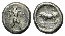 Northern Lucania, Poseidonia, c. 445-420 BC. AR Stater (17mm, 8.04g, 6h). Poseidon advancing r., wielding trident overhead. R/ Bull standing l. within...