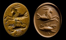 A roman yellow jasper intaglio. Seagoat and scorpion.