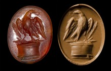 A roman carnelian intaglio. Eagle on an altar.