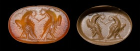 A roman carnelian intaglio. Military emblema.