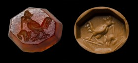 A roman carnelian octogonal intaglio. Cock and mouse.