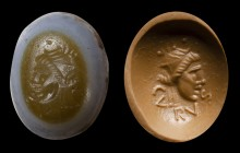 A roman republican three-layers agate intaglio. Mask.