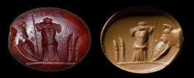 A roman carnelian intaglio. Panoplia. 