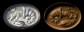 A roman chalcedony intaglio. Dog in a shell attacking a dolphin.