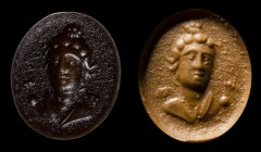 A roman brownish glass paste intaglio. Bust of Apollo. 