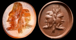 A roman carnelian intaglio. Two theatrical masks. 