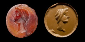 A roman carnelian intaglio. Head of Dioscuri with a star. 