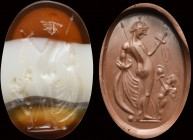 An italic banded agate intaglio. Venus Victrix with Cupid.