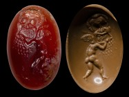 A roman carnelian intaglio. Eros with a theatrical mask. 