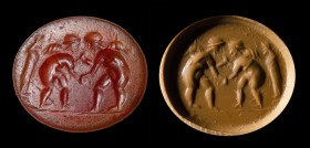 A roman carnelian intaglio. Winged erotes fighting.