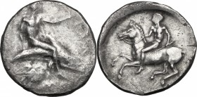 Greek Italy. Southern Apulia, Tarentum. AR Nomos, c. 425-380 BC. D/ Phalanthos astride dolphin right, pecten below; to right, traces of ethnic. R/ Hor...
