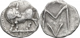 Greek Italy. Southern Lucania, Sybaris. AR Obol, 550-510 BC. D/ Bull standing left, head right; V M in exergue. R/ Large M/V; four pellets around. HN ...