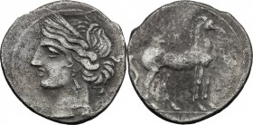 Greek Italy. Bruttium, Carthaginians in South-West Italy. AR Quarter Shekel, c. 215-205 BC. D/ Wreathed head of Tanit left. R/ Horse standing right. H...