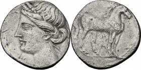 Greek Italy. Bruttium, Carthaginians in South-West Italy. AR Quarter Shekel, c. 215-205. D/ Wreathed head of Tanit left. R/ Horse standing right; belo...