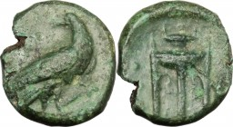 Greek Italy. Bruttium, Kroton. AE Hemiobol, c. 375-325 BC. D/ Eagle standing right, head reverted; above, A; below, cross-torch. R/ Tripod; to left, t...