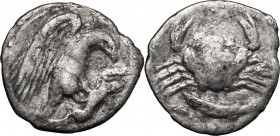 Sicily. Akragas. AR Hemidrachm, c. 420-406 BC. D/ Eagle standing right on, and tearing at, hare. R/ Crab; below, fish right. SNG ANS 1010-1; HGC 2,105...