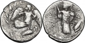 Sicily. Kamarina. AR Litra, c. 461-435 BC. D/ Nike flying right; below, swan standing right; all within wreath. R/ Athena standing left, holding spear...