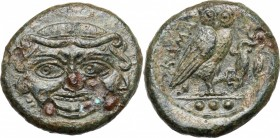 Sicily. Kamarina. AE Tetras or Trionkion, c. 420-405 BC. D/ Facing gorgoneion. Three countermarks (pellet in incuse circle) on nose, and flanking gorg...