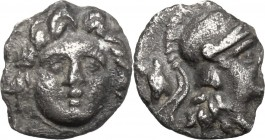 Greek Asia. Caria, Halikarnassos. AR Trihemiobol, c. 2nd-1st cent. BC. D/ Head of Rhodian Helios facing. R/ Bust of Athena right, wearing crested helm...
