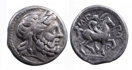 Kings of Macedonia, in the name of Philip II 359-336 BC, posthumous issue, Amphipolis Mint, ca. 323-315 BC. Laureate head of Zeus right; Nude youth on...