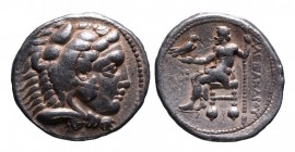 Kings of Macedonia, Alexander III the Great, 336-323 BC, lifetime issue, Tyre Mint, dated year 26, ca. 324-323 BC. Head of Herakles wearing lion's sca...