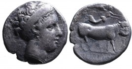 Campania, Neapolis, ca. 350-325 BC. Head of nymph wearing broad headband and earrings right; Man-faced bull standing right, head facing, above Nike fl...