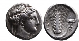 Lucania, Metapontum, ca. 340-330 BC. Head of Demeter wearing wreath of corn and earrings right; Ear of barley with leaf to right with cantharus on top...