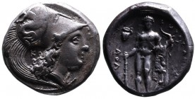 Lucania, Herakleia. Circa 330-281 BC. Head of Athena wearing Corinthian helmet decorated with Skylla hurling a stone, to right; behind, K.  Rev. Naked...