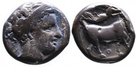 Campania, Neapolis, ca. 300-275 BC. Head of nymph wearing headband and earrings right; behind head X; Man-faced bull standing right, head facing, bene...