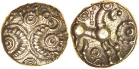 Corded Crescents. c.55-45 BC. Gold quarter stater. 9mm. 1.03g. Two snakelike corded crescents, forming six hidden faces, double ring above and below w...