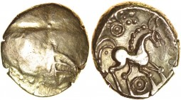 Snettisham. Rings Type. Talbot dies G/11. c.50-40 BC. Gold stater. 17mm. 5.57g. Plain, traces of incuse cross and three curved lines./ Horse right, do...