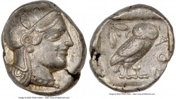 ATTICA. Athens. Ca. 455-440 BC. AR tetradrachm (26mm, 17.16 gm, 11h). NGC Choice VF 5/5 - 4/5. Early transitional issue. Head of Athena right, wearing...