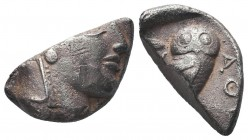 Attica, Athens AR Cut coin. Circa 454-404 BC. Helmeted head of Athena right / Owl standing right, head facing; olive sprig and crescent behind; AQE in...