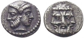 CILICIA. Uncertain. 4th century BC. Obol. Janiform head; on the left, a bearded male; on the right, a diademed female. Rev. Triform bearded male head....