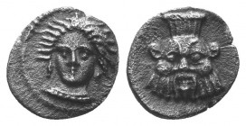 Cilicia, uncertain mint. AR Obol. c. 400-350 BC. Head of female facing slightly l. / Facing head of Bes, wearing kalathos. SNG Levante 233; SNG BnF 48...