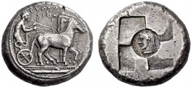 SICILY, Syracuse. Circa 510-500 BC. Tetradrachm (Silver, 22mm, 17.15 g 1). ϞΥΡΑϘΟ / ϞΙΟΝ Male charioteer, holding a goad in his right hand and the rei...