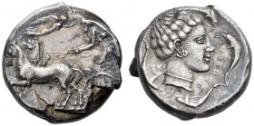 SICILY, Syracuse. Circa 440-430 BC. Tetradrachm (Silver, 23mm, 17.56 g 11). Male charioteer, wearing a long chiton and holding the reins in both hands...