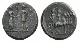 Aeolis, Kyme, 2nd century BC. Æ (16mm, 4.20g, 12h). Artemis, holding long torch, greeting the Amazon Kyme, holding sceptre. R/ Two figures (Apollo and...