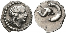 SPAIN. Uncertain. Late 3rd century BC. Tetartemorion (Silver, 7 mm, 0.18 g, 11 h). Laureate head of Apollo to right. Rev. Dolphin to right, swimming t...